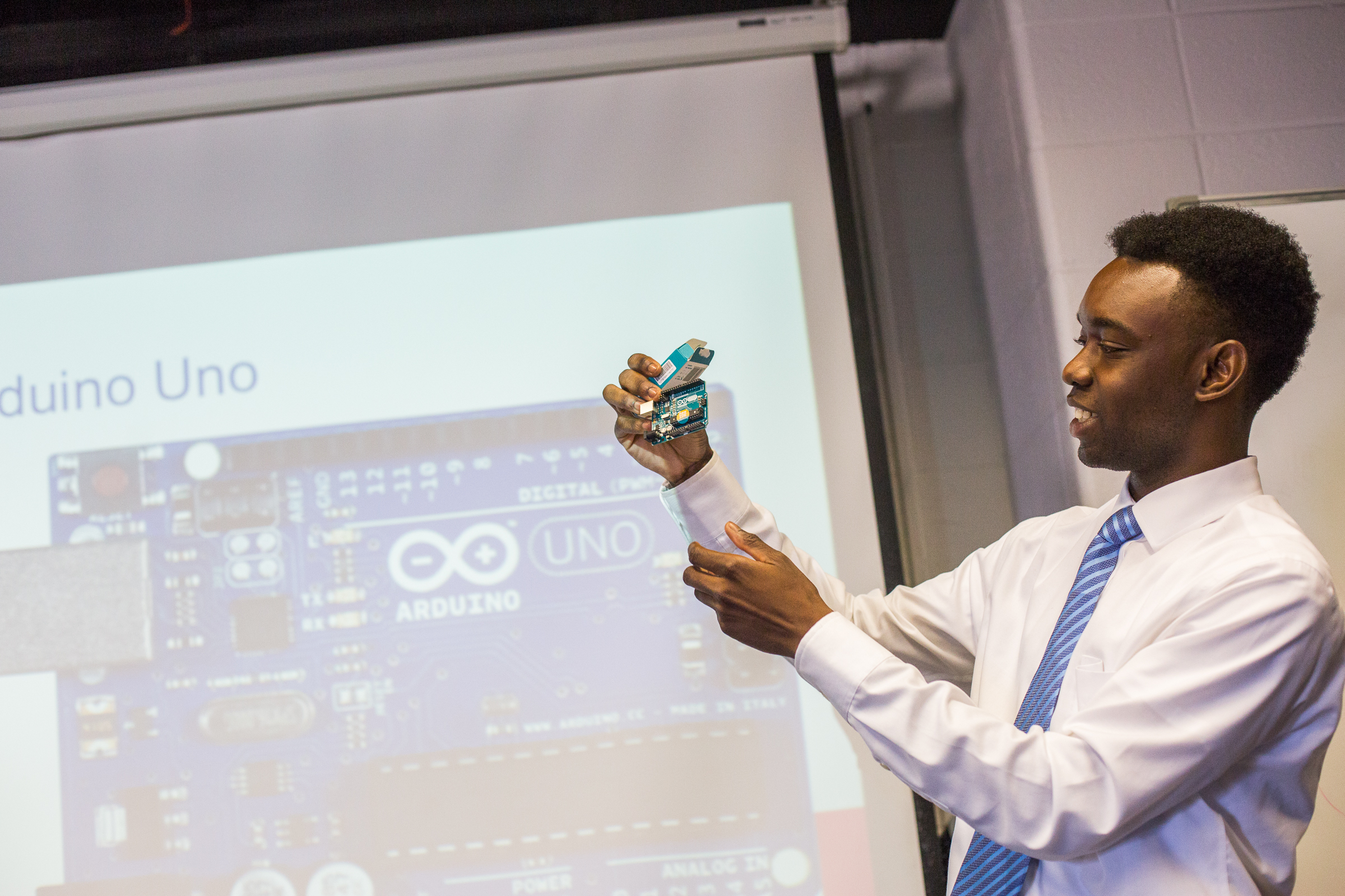An E.N.G. student holds up an arduino used in his research