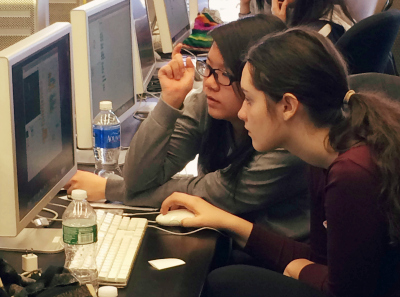 GWC students collaborate on a coding project