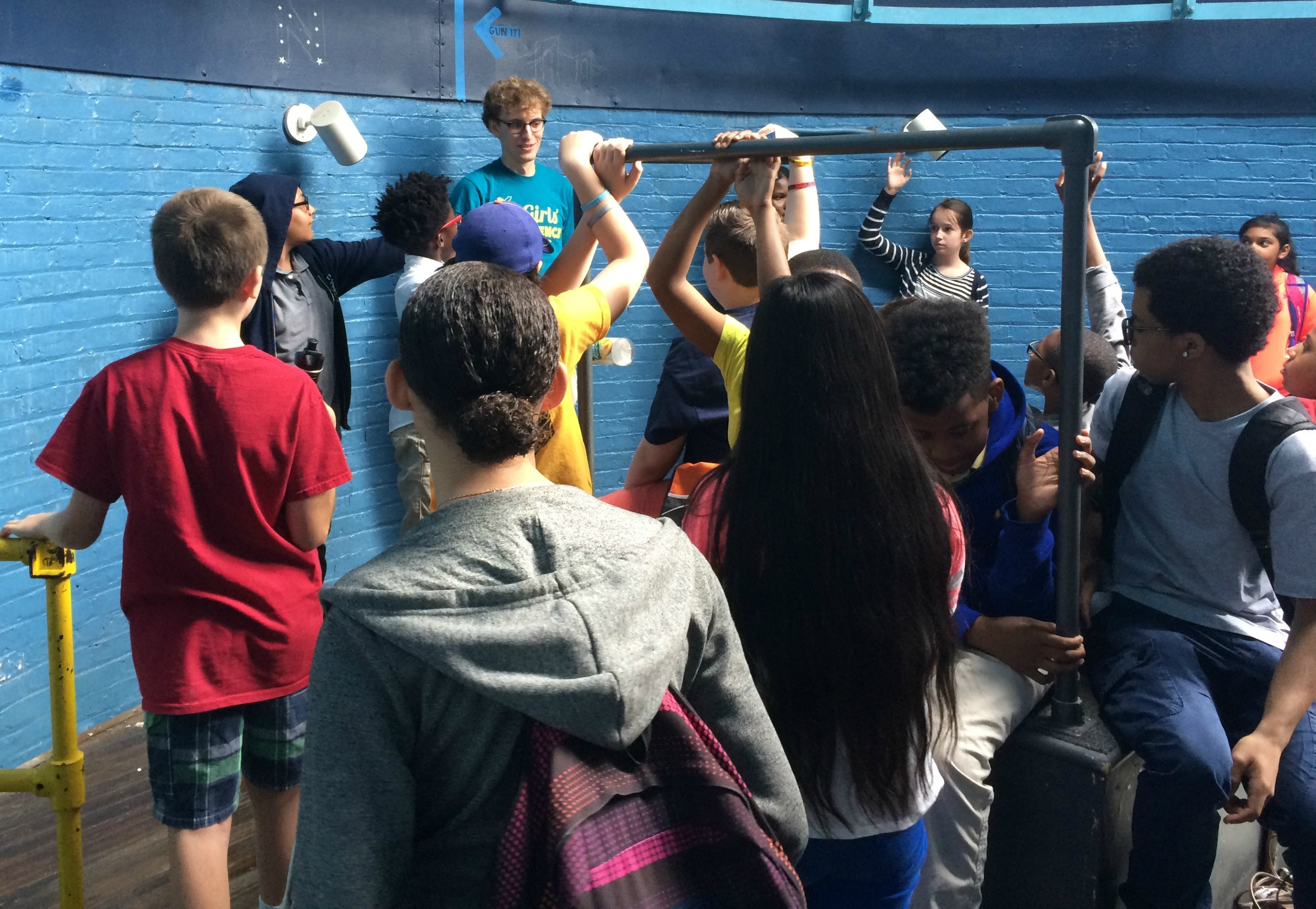 Students explore the observatory as part of a lab tour.