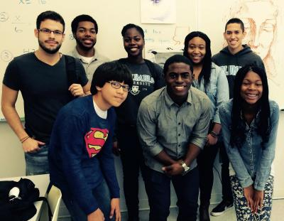 NSBE members take a photo with a group of students