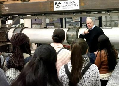 Professor Steven Sun gives a lab tour to students.