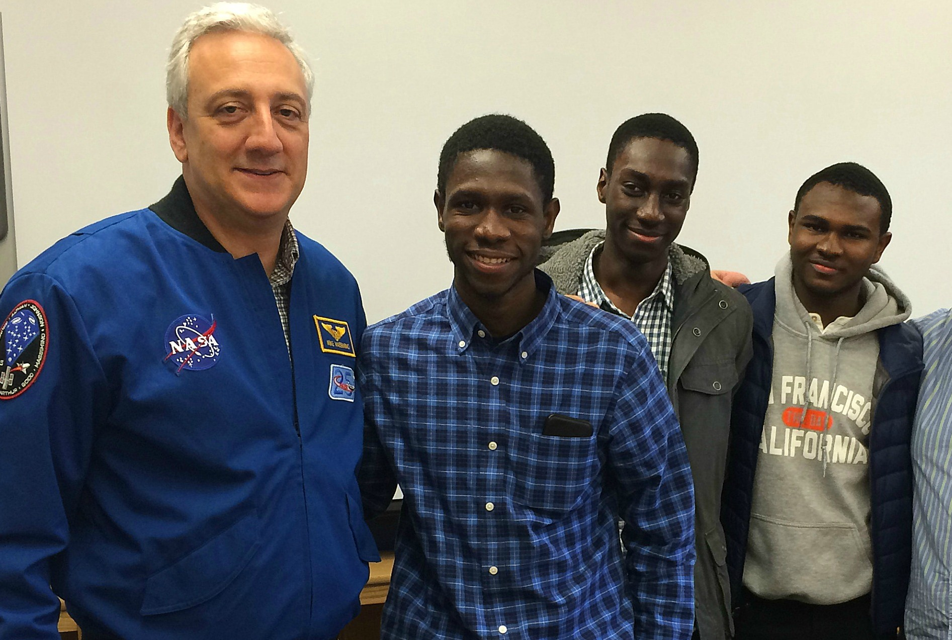 Professor and former NASA Astronaut Mike Massimino speaking with students from ELLIS Preparatory Academy.