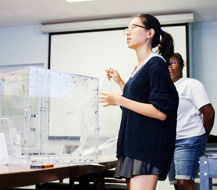 An Engineers Without Borders student conducts a presentation.